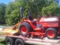 Kubota B2150 with 5 ft belly mower and 5 ft woods brush