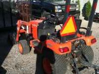 This is a 2006 Kubota BX2350. It has 23 HP. The unit