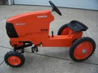 Kubota Pedal Tractor model M105S.  This is a hard to
