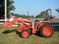 This is a 2003 L 2600 Kubota Tractor 4X4 With a Kubota