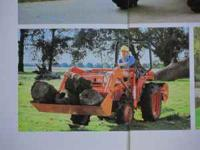 10 year old tractor with front loader/bucket and a