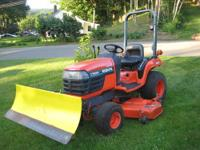 UP FOR SALE IS A VERY NICE KUBOTA MODEL BX2200 COMPACT