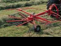 New, never used Kuhn hay rake. It is a 3-point hitch