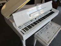 Beautiful High Polished White Baby Grand piano!