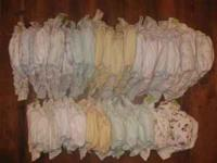 24 Kushies Ultra All-In-One cloth diapers. All are