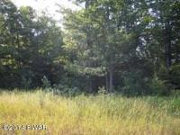 Wooded lot in a great location. Close to major