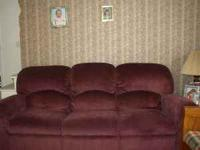 Cranberry sofa with built-in recliners on both ends...