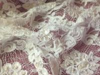 Beautiful White Aloncom lace fabric with tiny Pearls