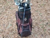 A complete Ladie's golf set including bag, woods,