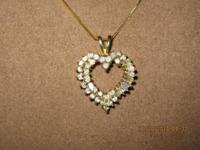 Ladies Diamond Heart Pendant set in 14K Y/Gold. One (1)