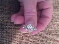 One ladies platinum engagement ring containing ten