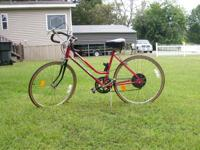 Ladies 10 speed Huffy bike with drink holder for sale
