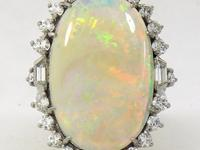 This classic 1950's opal and diamond ring is set with