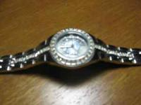 "Beautiful watch with ""diamonds"" around the face and"