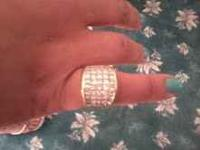 The ring is nearly new; it is a size 14 band, 18 karat
