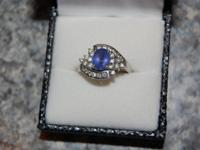 This beautiful white gold , oval, tazanite medium