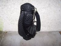 USED LADIES BLACK CLOTH GOLF BAG. COMES WITH SNAP ON