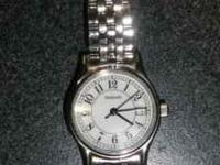Ladies SS Tiffany wrist watch, like new.......$350.00