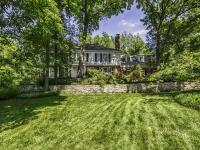 Gracious Colonial set on private 1+ acre of beautifully