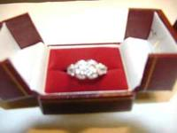 LADY'S 14 CARAT WHITE GOLD DIAMOND ENGAGEMENT RING