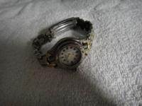 THIS LADY ELEGANT WATCH WAS MADE IN JAPAN. IT'S IN AN