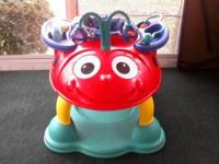 Safety First lady bug bouncer with various activities.