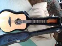 "this is a 12 string guitar I have.its a ""lAG"".its in"