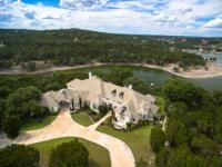 This lakefront Austin area estate home is sited on a