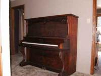 The piano is an older make but in good shape. It has a