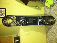 Lamar snowboard with burton freestyle bindings. . Also
