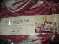 I have a 6 piece crib set. color is raspberry swirl.
