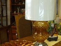 Very 70's in this amber light with brass feet. Original