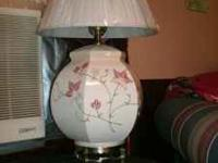 Assorted lamps for sale. Round floral designed are