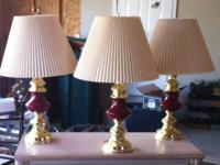 Set of three maroon table lamps. Cash Only.