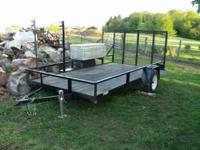 landscape trailer with lights, ramp, and diamond plate