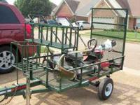 Trailer is 3x6, green, with weedeater rack and gas/tool
