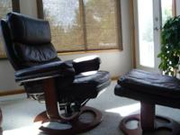 Mahogany leather chair and ottoman in excellent