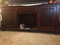 "LANE TV STAND. Good condition. Holds 72"" tv. Plus a"