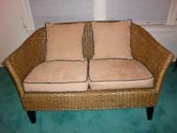 Pier One lacquered woven rattan settee (love seat) with