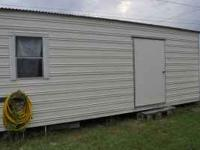 This shed has a large roll-up door, and the ramp allows