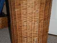 Large basket in good shape has lid. 27 inches tall.