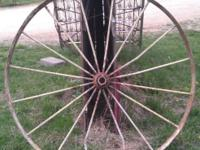 We have Large 4' Wagon Wheel. It is in good condition.
