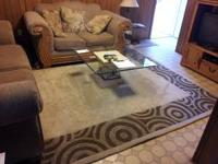 This is a tan/brown handtufted wool rug. It's 100% wool