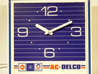 """22"""" x 22"""" x 6"""" wall clock made by The Howard Company in"""