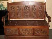 This is a fabulous and very large carved mud room bench