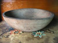 This old wooden dough bowl has lots of character and