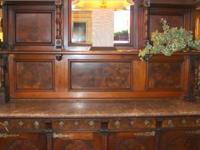 This fabulous antique sideboard once graced the