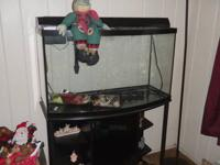 Very large aquarium for sale. Comes equip with light
