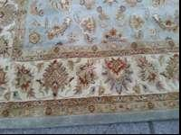 This us a new plush area rug done in the greens and a