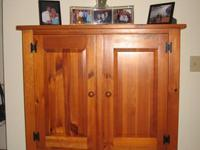 1 large armoire (3 large drawers and shelves) for sale.